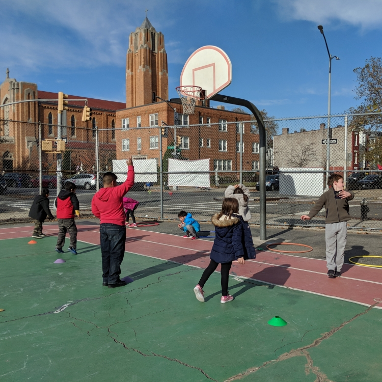 students on the basketball court at the lower school