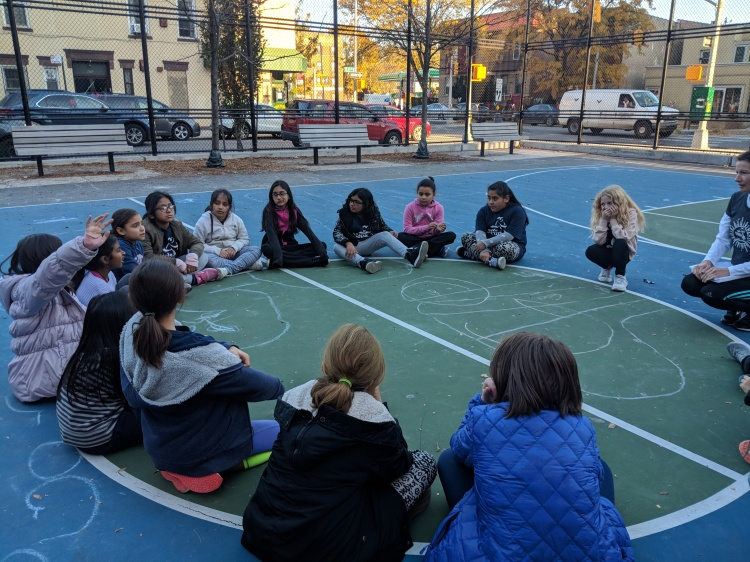 students at PE on the lower school playground