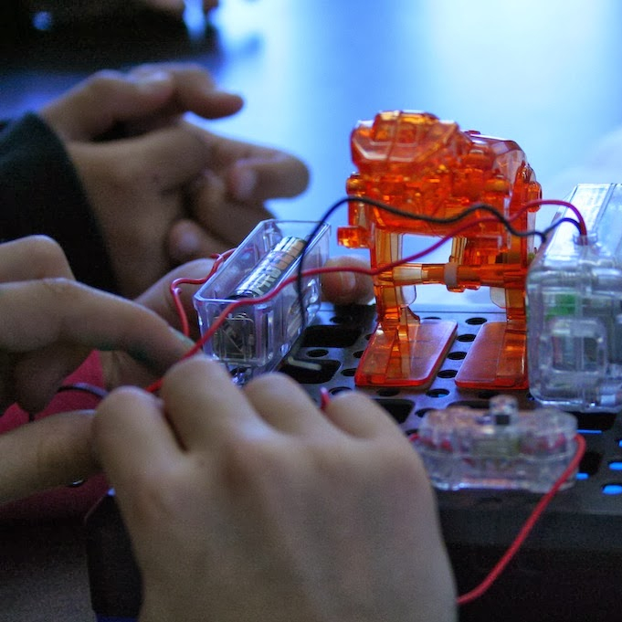 students tinker with a robot