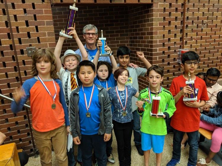 chess team poses with trophies